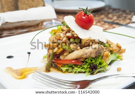 salad greens and vegetables on a plate in a restaurant