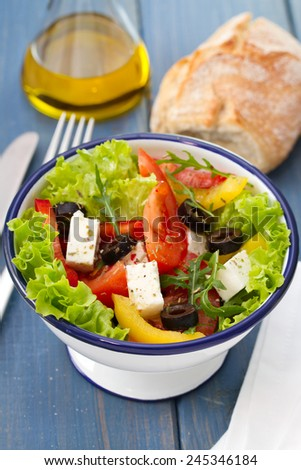 salad in bowl with bread and napkin #245346184