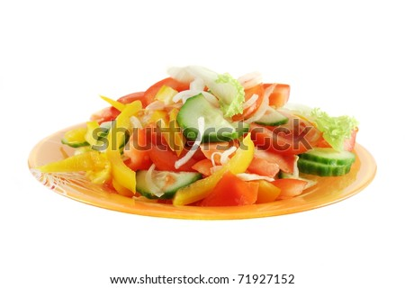 salad made up of fresh cut vegetables (tomato, cucumber, onion, sweet pepper and leaf lettuce), in orange glass plate, isolated on white