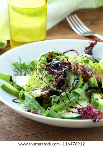 salad mix with avocado and cucumber,  with balsamic dressing