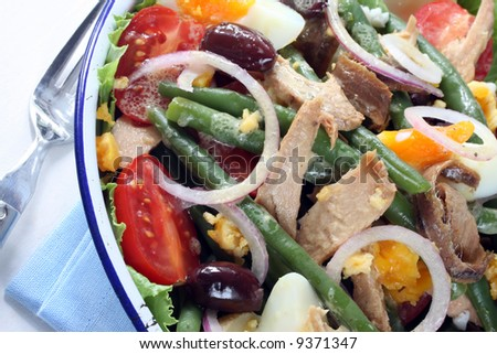 Salad Nicoise. Tuna salad with green beans, eggs, chat potatoes, black ...