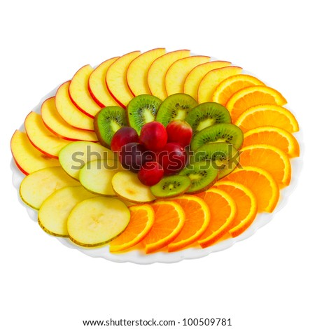 Salad of apples oranges grapes kiwi fruit slices on a plate isolated ...