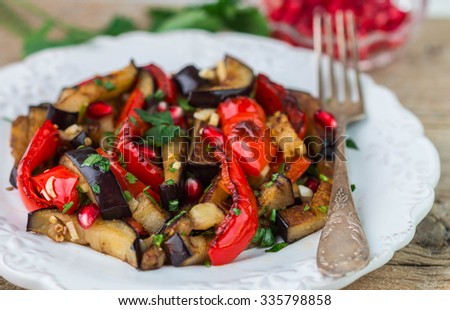 Salad of baked vegetables. Eggplant and bell peppers with pomegranate