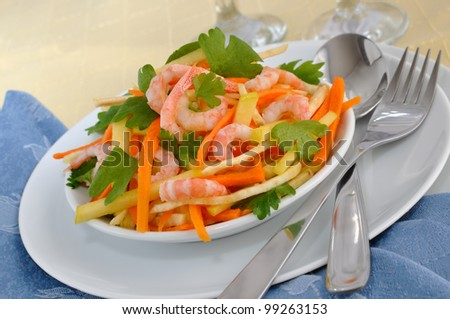 Salad of celery root and leaves with carrots, apples and shrimp