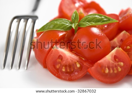 Salad of cherry tomato with a fork