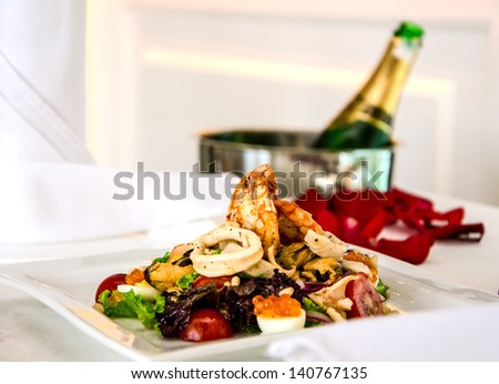 salad of seafood on plate in restaurant