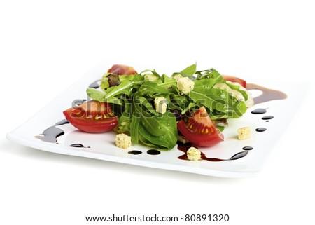 Salad plate garnished with balsamic vinegar