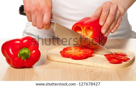 Salad preparation - cutting red pepper into pieces