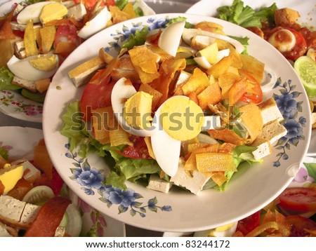 Salad thailand (Salad-khaek) - Indian food on white dish on red table