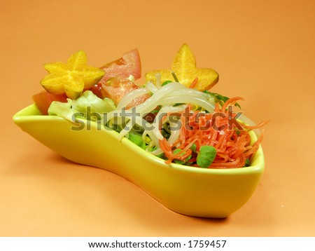 Salad whit tropical fruit and vegetables - stock photo
