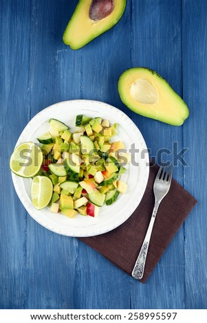 Salad with apple and avocado in bowl on table close up #258995597
