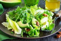 Salad with avocado and pecans.