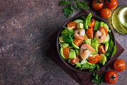 salad with avocado and shrimps in bowl, top view, copy space