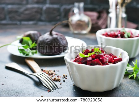 salad with boiled beet in the bowls