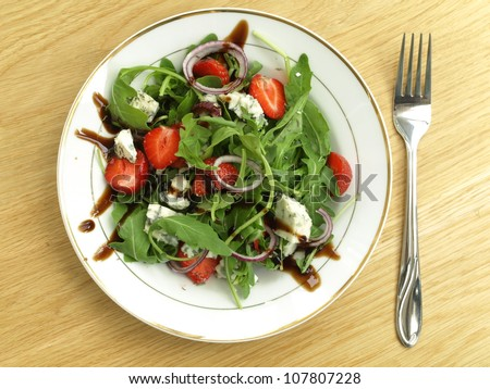 Salad with cheese, strawberries and spinach, bird eye view