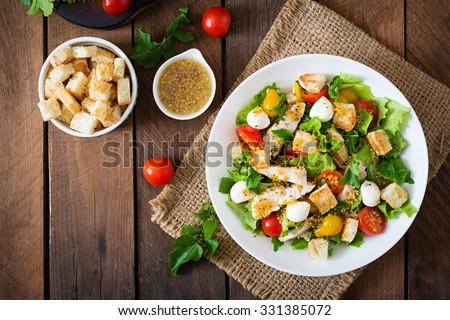 Salad with chicken, mozzarella and cherry tomatoes. Top view #331385072