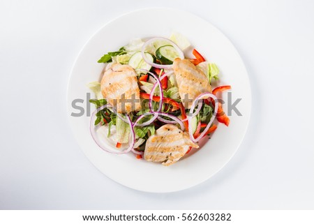 salad with chicken on a white plate on a light background (close top view) #562603282