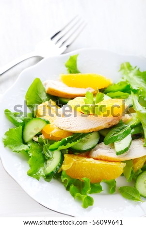 salad with chicken, orange and cucumber