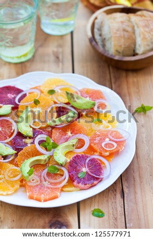 Salad with Citrus Fruits, Avocado and Onion. Ready-to-eat. Also available in horizontal format.