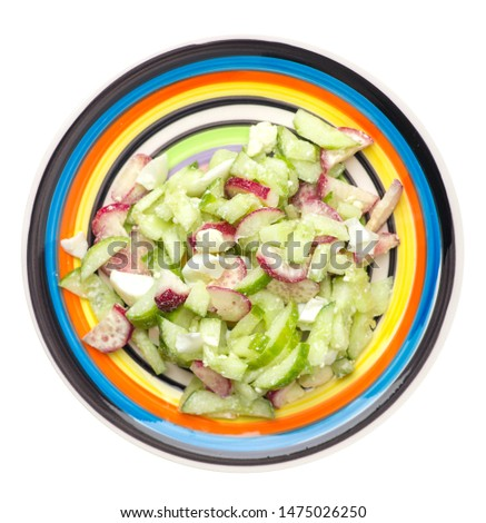 salad with cucumbers and eggs on a multicolored plate isolated on white background .healthy food . vegetarian food top view. Asian cuisine