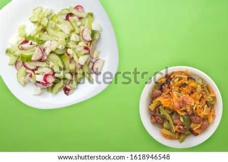 salad with cucumbers and eggs on a white  plate on  lime background .healthy food . vegetarian food top view. Asian cuisine
