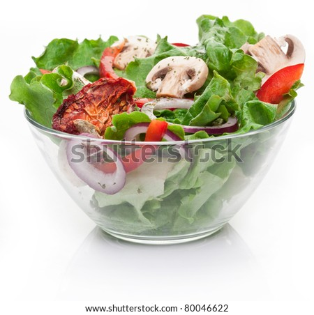 Salad with dried tomatoes, champignon and onion. - stock photo