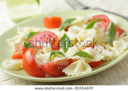 Salad with farfalle pasta, tomato, basil, and mozzarella