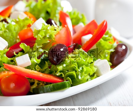 Salad with feta and greek olives - stock photo
