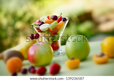 Salad with fresh organic fruits