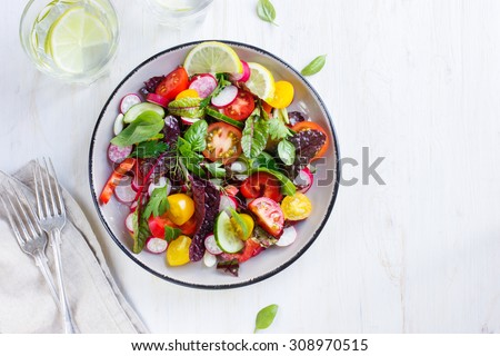 Stock Photo Salad with fresh summer vegetables, top view