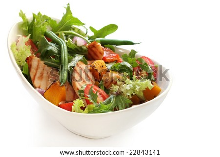 Salad with grilled chicken breast, mixed greens, roasted vegetables, tomatoes, beans, capsicum, onion, pumpkin.  Delicious healthy eating.