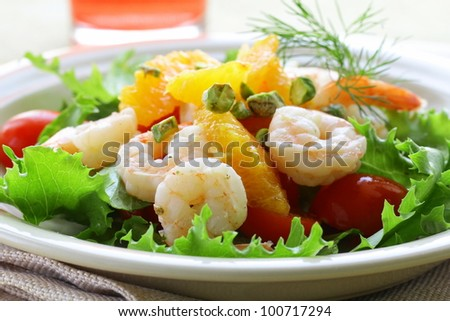 salad with grilled shrimp, orange and pistachios