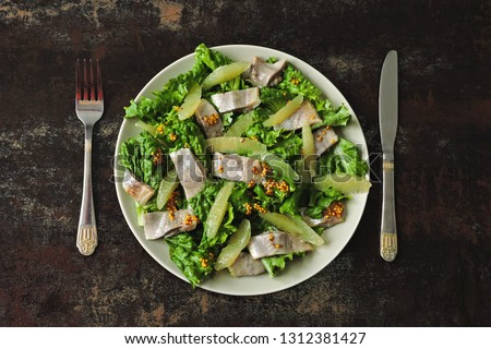 Salad with herring and lemon fillet. Paleo diet, keto diet, pegan diet. Healthy fitness salad with lemon and fish. #1312381427