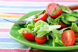 salad with lettuce and cucumber, arugula and cherry tomatoes