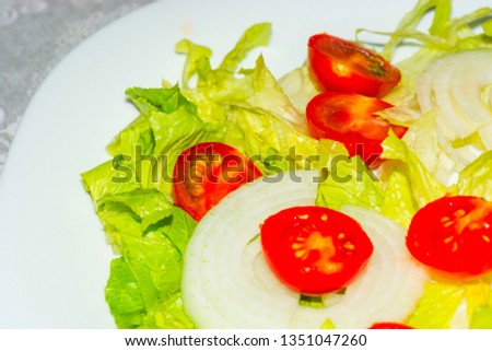 Salad with lettuce and tomato. Fresh and summer dish. typical of Sicily and the Mediterranean. The Mediterranean diet. #1351047260