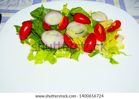 Salad with lettuce and tomato. Fresh and summer dish. typical of Sicily and the Mediterranean. The Mediterranean diet. #1400656724