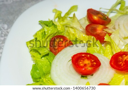 Salad with lettuce and tomato. Fresh and summer dish. typical of Sicily and the Mediterranean. The Mediterranean diet. #1400656730