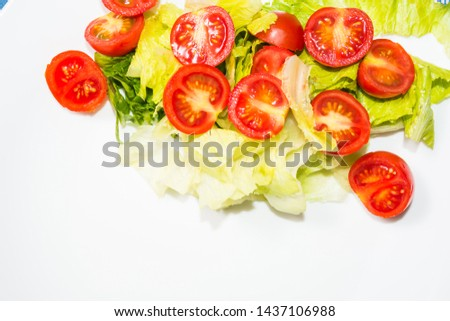 Salad with lettuce and tomato. Fresh and summer dish. typical of Sicily and the Mediterranean. The Mediterranean diet. #1437106988