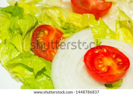 Salad with lettuce and tomato. Fresh and summer dish. typical of Sicily and the Mediterranean. The Mediterranean diet. #1448786837