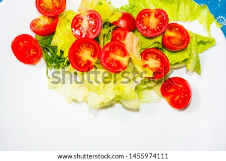 Salad with lettuce and tomato. Fresh and summer dish. typical of Sicily and the Mediterranean. The Mediterranean diet. #1455974111