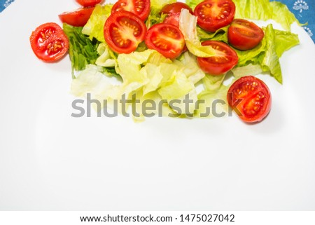Salad with lettuce and tomato. Fresh and summer dish. typical of Sicily and the Mediterranean. The Mediterranean diet. #1475027042