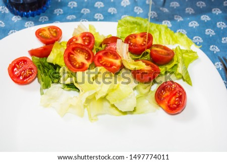 Salad with lettuce and tomato. Fresh and summer dish. typical of Sicily and the Mediterranean. The Mediterranean diet. #1497774011