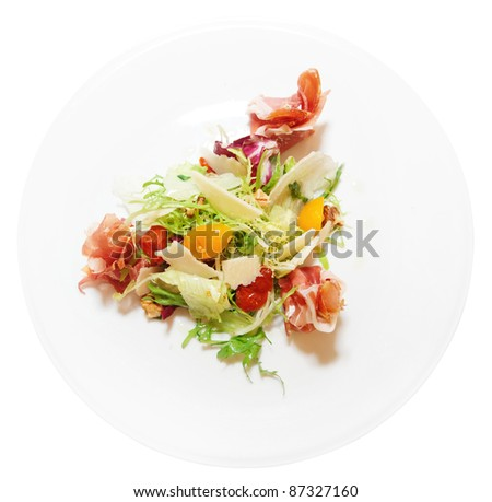 Salad with prosciutto ham, ripened cheese, dried cherry tomatos and lettuce