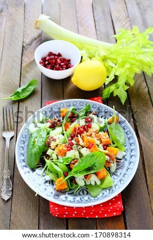 salad with pumpkin and stem celery, food closeup