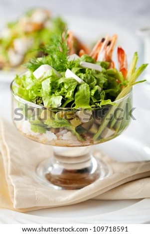 Salad with Shrimp, Fresh Salad Leaf, Rice and Avocado - stock photo
