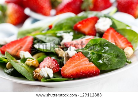 salad with strawberry, spinach leaves and feta cheese
