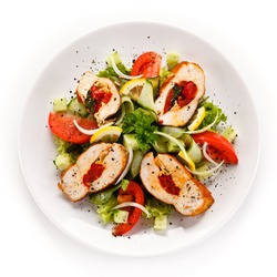 Salad with stuffed chicken fillet on white background