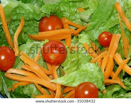 Salad with tomatoes and carrots background