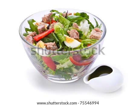 Salad with tuna fish boiled egg and vegetable on white