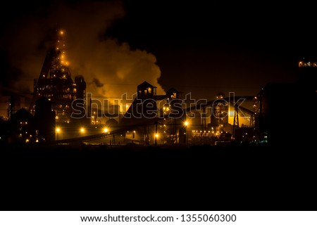 Saladanha Coal power station at night with light on and smoke rising of buildings with gas blue flames coming out flare stack is South Africa west coast.  #1355060300